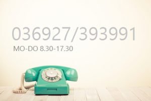 Retro rotary telephone on wooden table